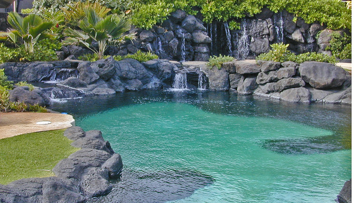 Hawaii water features: waterfalls into pool.